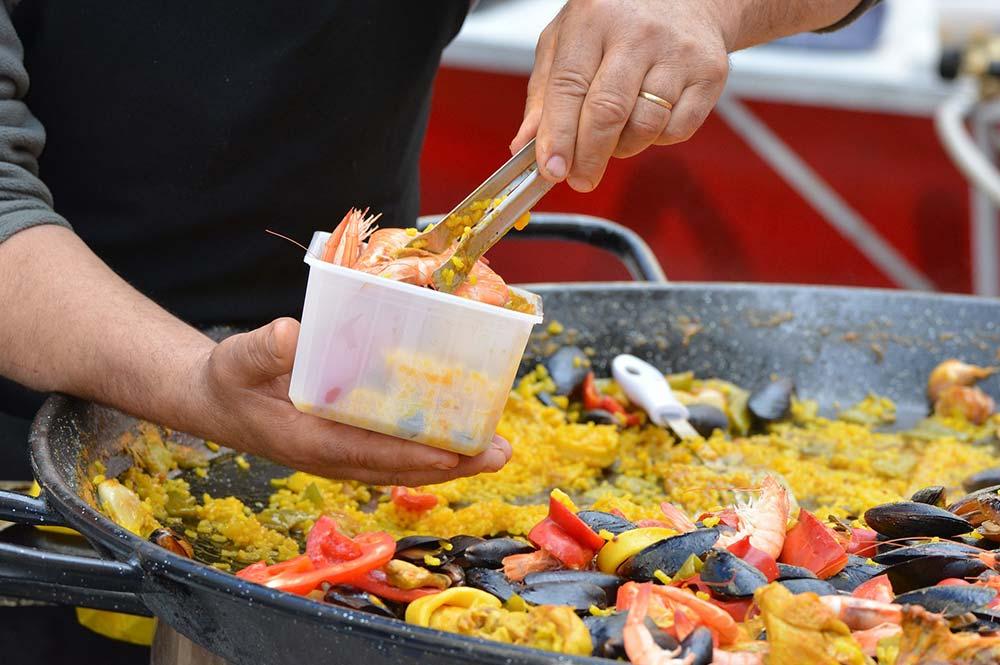 Neil Emery Chef from edible bike tours creating masterclass seafood paella in el jaral el gastor spain