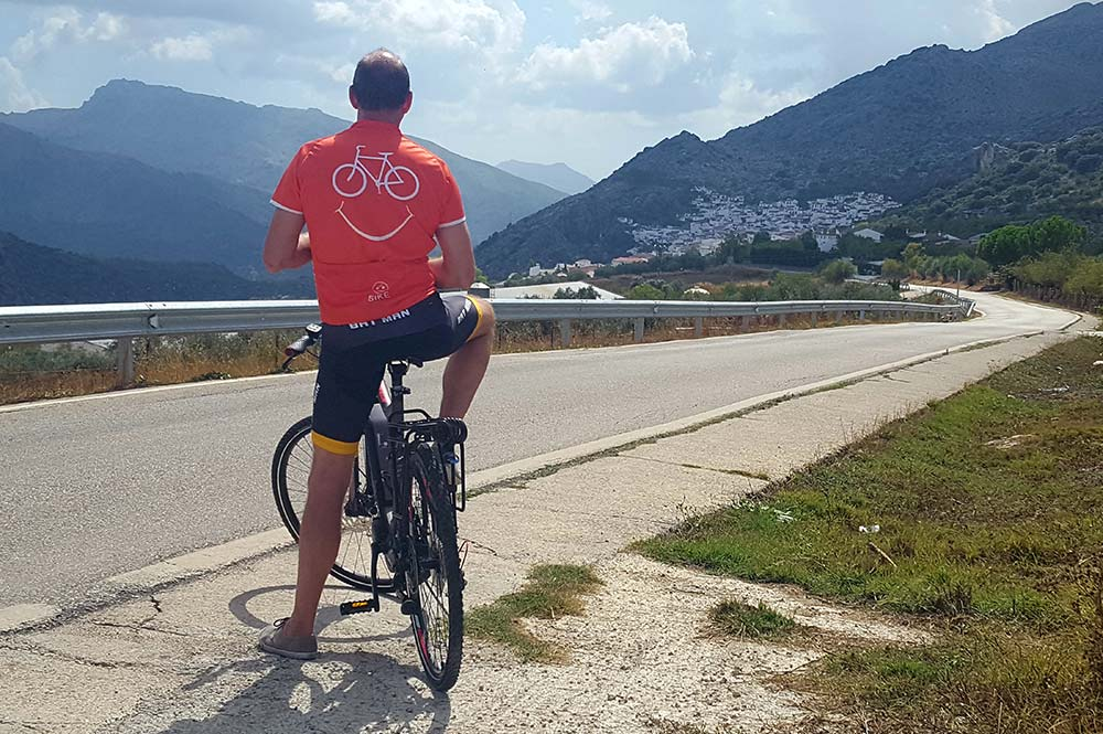 neil emery edible bike tours chef stopping while cycling on his ebike to look at montejaque village spain