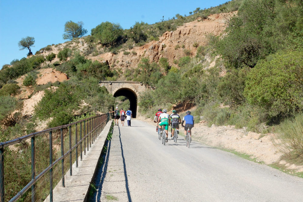 Cycling through tunnels with Edible Bike Tours on the via verde, Cadiz, Spain